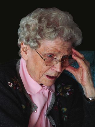 Elderly woman head-hand