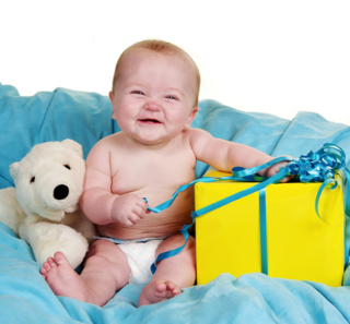 Bigstock-Baby-With-A-Present-And-A-Big--3710823