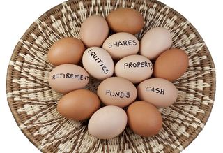 Bigstock-Basket-Egg-Investment-Portfoli-56443334