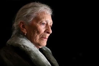 Elder woman with concerned face
