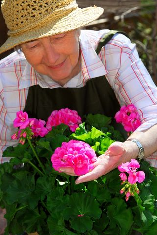 Elderly women tending to flowers