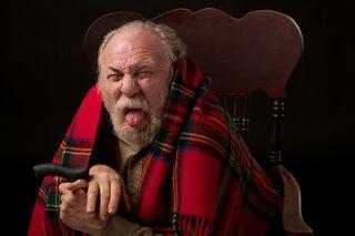Bigstock-Grumpy-old-man-with-shawl-and--35175818