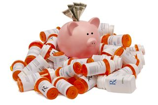 Bigstock-Pink-Piggy-Bank-with-Money-Sit-38011810