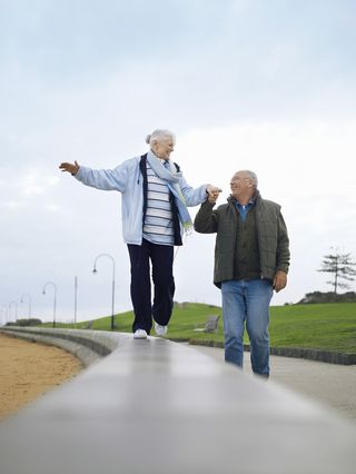 Bigstock-Happy-senior-couple-walking-on-47247994