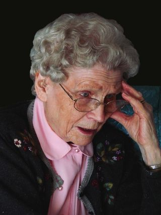 Elder woman with concerned face and glasses