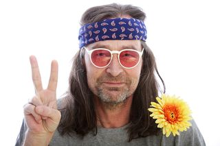 Bigstock-Male-Hippie-Making-A-Peace-Sig-44059396