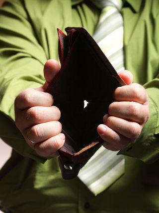 Bigstock-Empty-Wallet-In-Male-Hands--P-44342176