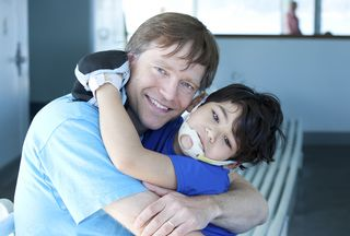 Bigstock-Disabled-Boy-Giving-Father-A-B-38161828