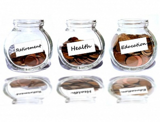 Retirement-and-health-and-education-concept--coins-in-the-jar-